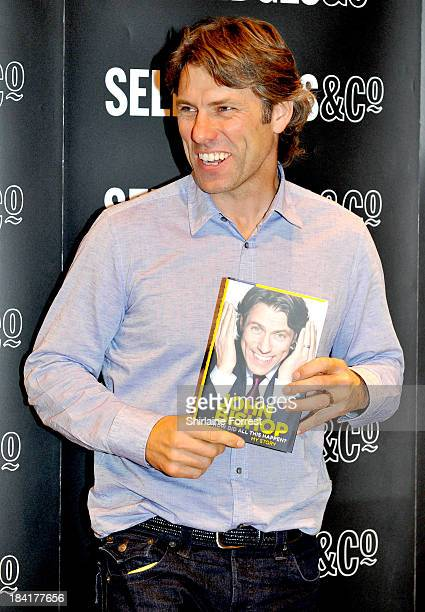 John Bishop meets fans and signs copies of his book 'How Did All This Happen My Story' at Selfridges on October 11 2013 in Manchester England