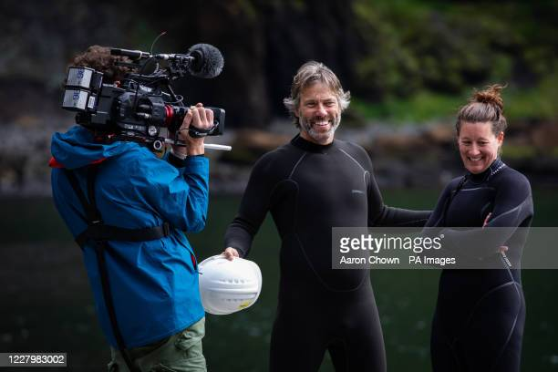 John Bishop talks to Jessica Whiton, a member of the Sea Life Trust care team, after the transfer of Beluga whales Little Grey and Little White from...