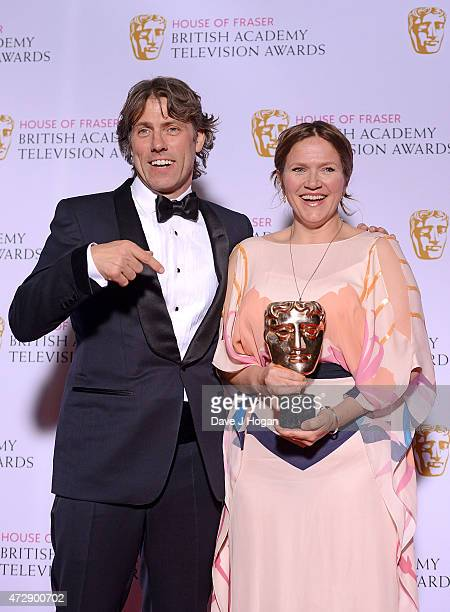 John Bishop with Jessica Hynes winner of Best Female Performance in a Comedy Programme for 'W1A' pose in the winners room at the House of Fraser...