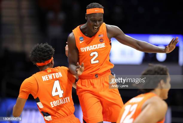 John Bol Ajak and Woody Newton of the Syracuse Orange celebrate the victory against the San Diego State Aztecs in the first round game of the 2021...