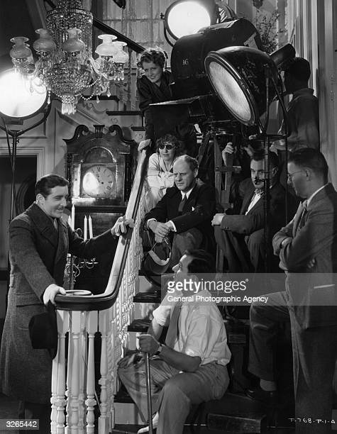 John Boles Irene Dunne and director Philip Moeller on set with the crew of the RKO production 'Age Of Innocence'
