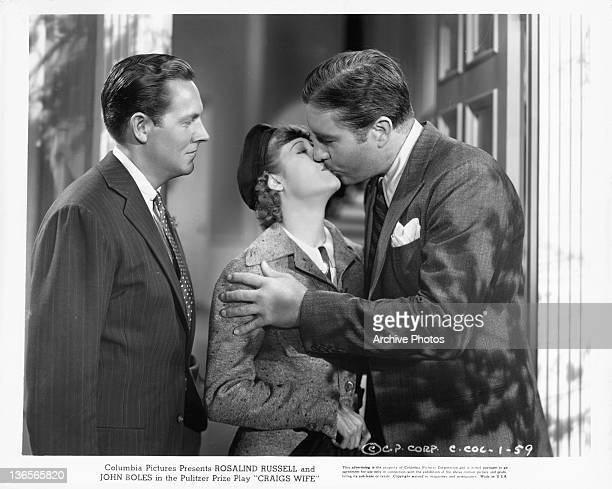 John Boles kissing unidentified woman in a scene from the film 'Craig's Wife' 1936