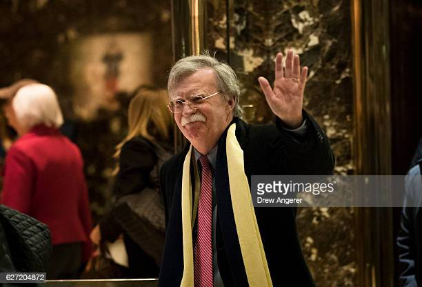 John Bolton, former United States Ambassador to the United Nations, waves as he leaves Trump Tower, December 2, 2016 in New York City....