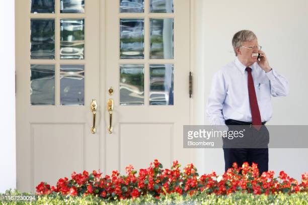 John Bolton, national security adviser, speaks on a mobile device outside the West Wing of the White House in Washington, D.C., U.S., on Tuesday,...