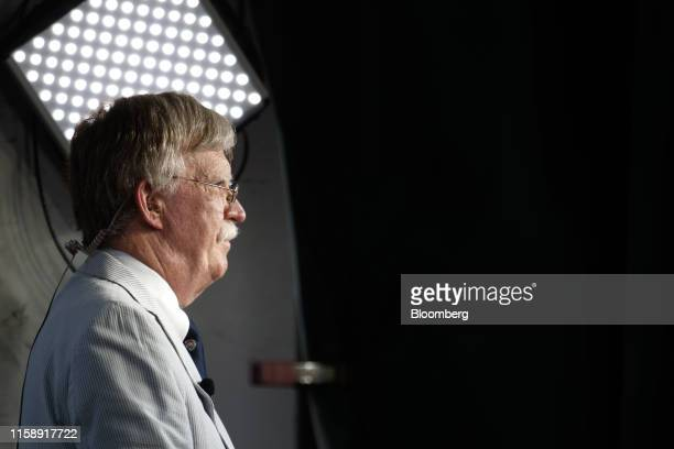 John Bolton national security adviser stands during a television interview outside the White House in Washington DC US on Wednesday July 31 2019 The...