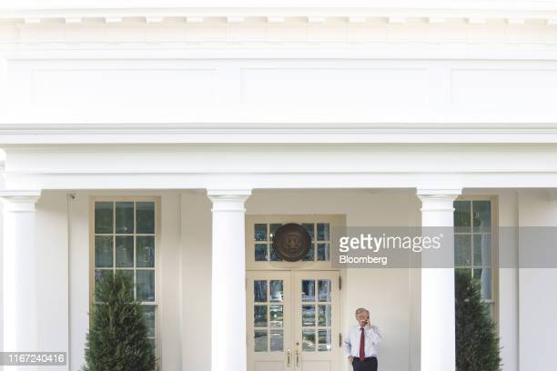 John Bolton national security adviser uses a mobile phone outside the West Wing of the White House in Washington DC US on Tuesday Sept 10 2019...