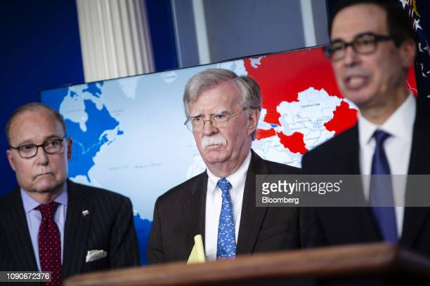 John Bolton national security advisor center and Larry Kudlow director of the US National Economic Council left listen while Steven Mnuchin US...