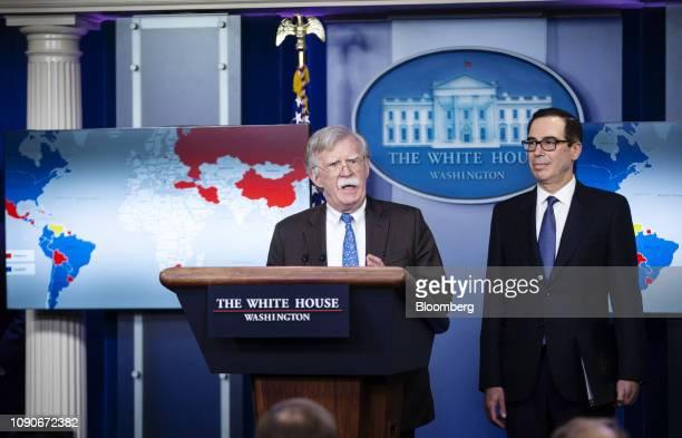 John Bolton national security advisor center speaks while Steven Mnuchin US Treasury secretary listens during a White House briefing in Washington DC...