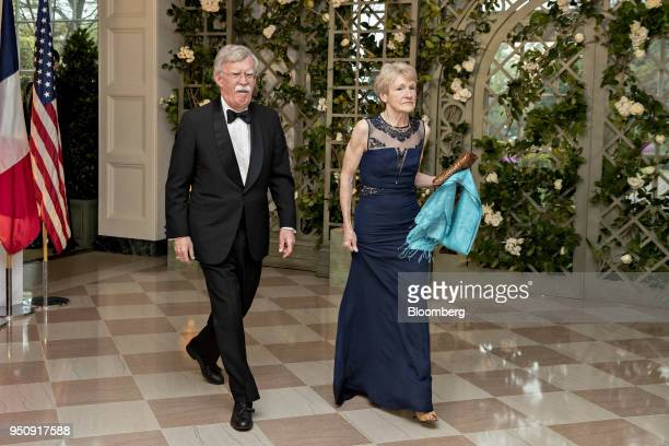 John Bolton national security advisor left and Gretchen Bolton arrive for a state dinner in honor of French President Emanuel Macron at the White...