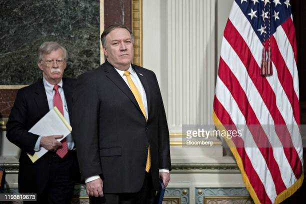 John Bolton national security advisor left and Mike Pompeo US secretary of state attend an Interagency Task Force to Monitor and Combat Trafficking...