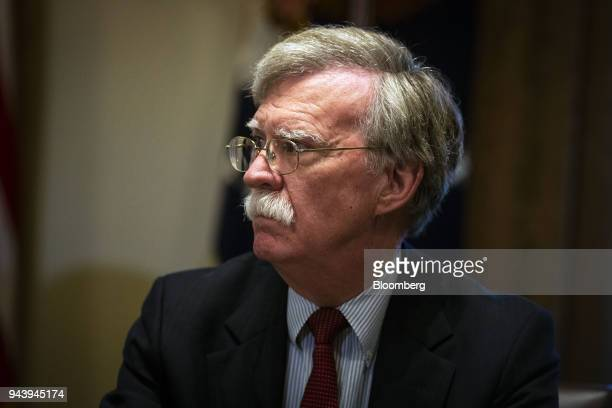 John Bolton national security advisor listens as US President Donald Trump not pictured speaks during a meeting with senior military leadership in...