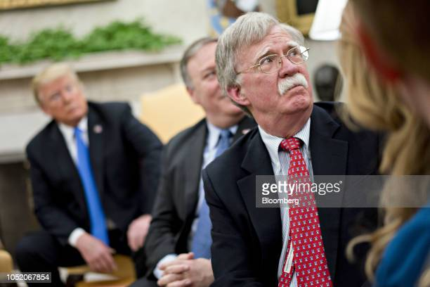 John Bolton national security advisor listens during a meeting with US President Donald Trump and US Pastor Andrew Brunson not pictured in the Oval...