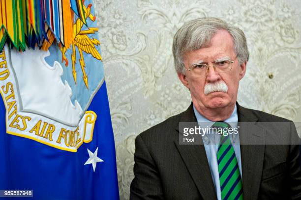 John Bolton national security advisor listens during a meeting with US President Donald Trump and Jens Stoltenberg secretary general of the North...