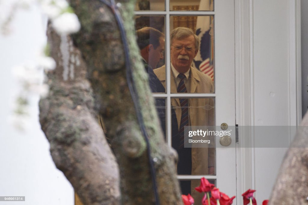 John Bolton, national security advisor, right, is seen before departing on Marine One for Miami with U.S. President Donald Trump, not pictured, on the South Lawn of the White House in Washington, D.C., U.S. on Monday, April 16, 2018. Trumpaccused China and Russia of devaluing their currencies, opening a new front in his argument that foreign governments are taking advantage of the U.S. economy to support their own expansions. Photographer: Joshua Roberts/Bloomberg via Getty Images