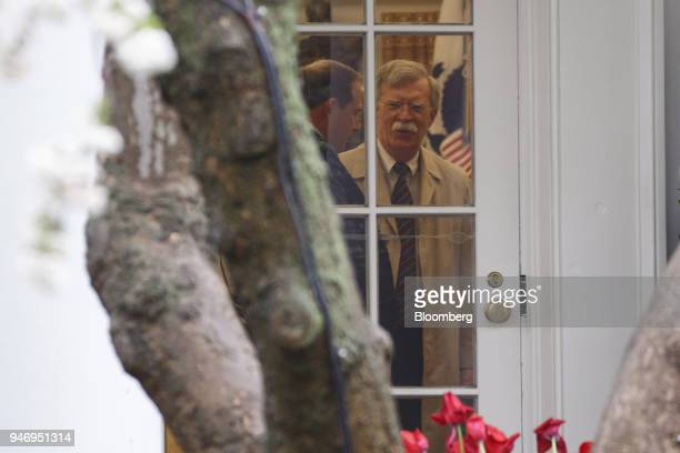 John Bolton national security advisor right is seen before departing on Marine One for Miami with US President Donald Trump not pictured on the South...