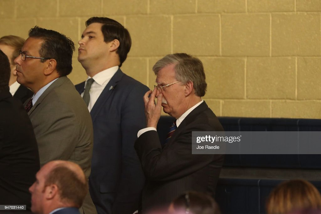 John Bolton, the national security adviser, listens as President Donald Trump speaks during a roundtable discussion about the Republican $1.5 trillion tax cut package he recently signed into law on April 16, 2018 in Hialeah, Florida. Trump was joined by local business owners as well as Sen. Marco Rubio (R-FL), Treasury Secretary Steven Mnuchin, Labor Secretary Alex Acosta and others.