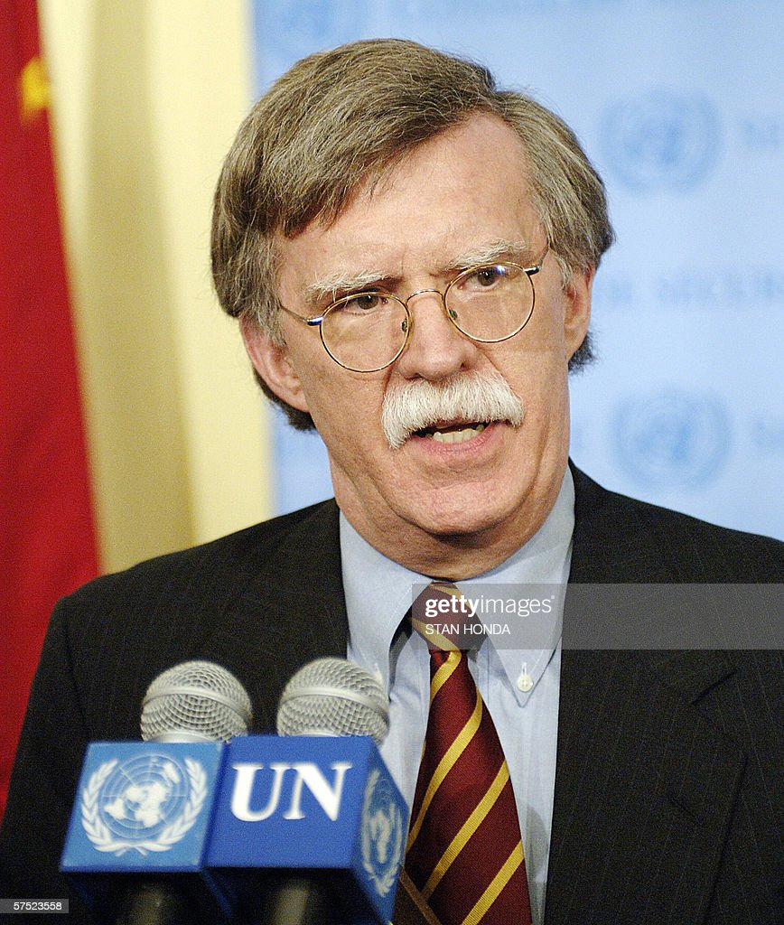 John Bolton, United States ambassador to the United Nations, speaks to the media outside the Security Council chambers, 03 May, 2006, just after the Council discussed a draft resolution on Iran's nuclear program at UN headquarters in New York. The Council on Wednesday wrapped up nearly two hours of closed-door consultations at which France and Britain circulated a draft resolution legally obliging Iran to freeze uranium enrichment work. The text, worked out in close consultations with Germany and the United States, invokes Chapter 7 of the UN Charter, which can authorize economic sanctions or even as a last resort the use of force in cases of threats to international peace and security. AFP PHOTO/Stan HONDA