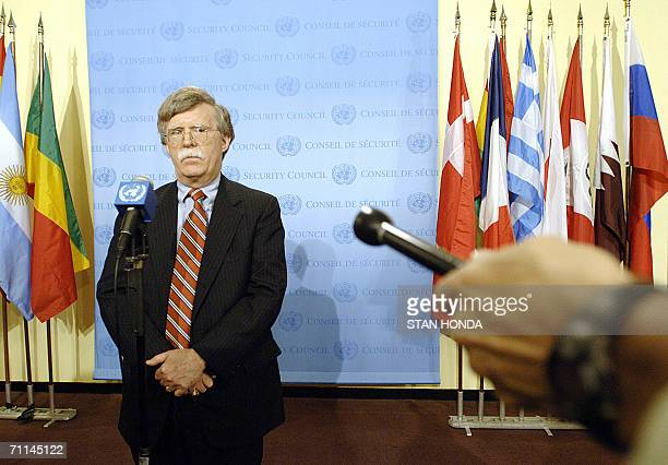 John Bolton, US ambassador to the United Nations, responds, 07 June outside the Security Council chambers at UN headquarters in New York, to a speech...