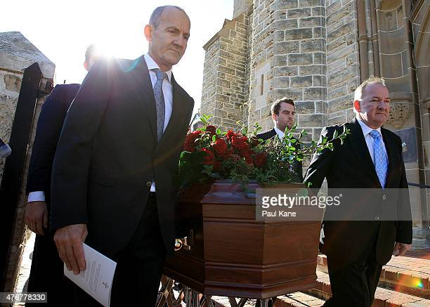 John Bond and Craig Bond lead the funeral prosession with the casket of their father Alan Bond at St Patrick's Basilica on June 12 2015 in Perth...