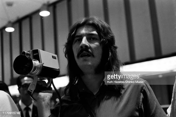 John Bonham of Led Zeppelin, holding an Akai video camera in the arrivals lobby at Haneda Airport, Tokyo, Japan, 21st September 1971.