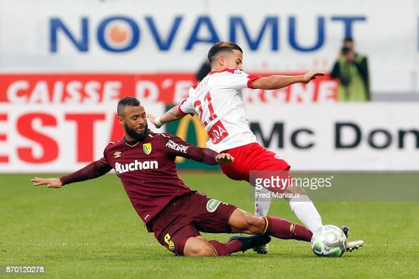 John Bostock of Lens and Amine Bassi of Nancy during the French Ligue 2 match between Nancy and Lens at Stade Marcel Picot on November 4 2017 in...