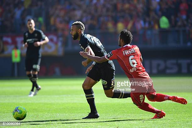John Bostock of Lens and Angelo Fulgini of Valenciennes during the French Ligue 2 match between Valenciennes FC v Racing Club de Lens at Stade du...