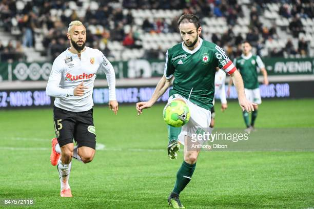 John Bostock of Lens and Jerome Hergault of Red Star during the French Ligue 2 match between Red Star and Lens at Stade Jean Bouin on March 3 2017 in...
