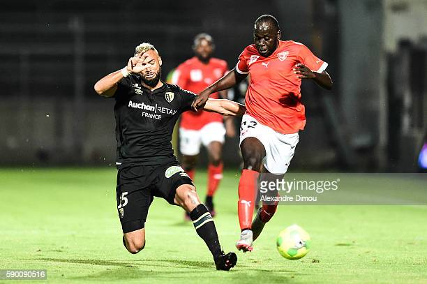 John Bostock of Lens and Sada Thioub of Nimes during the Ligue 2 game between Lens and Nimes on August 15 2016 in Nimes France