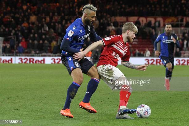 John Bostock of Nottingham Forest battles with Middlesbrough's Hayden Coulson during the Sky Bet Championship match between Middlesbrough and...