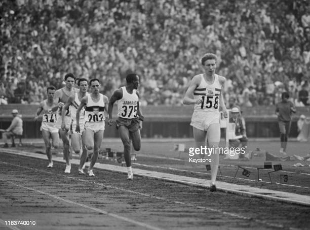 John Boulter of Great Britain leads George Kerr of Jamaica during Heat Five of the Men's 800 metres competition on 14th October 1964 during the XVIII...