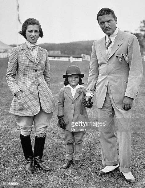 John Bouvier stands with his wife and daughter Jaqueline at the Sixth Annual Horse Show of the Southampton Riding and Hunt Club on Long Island