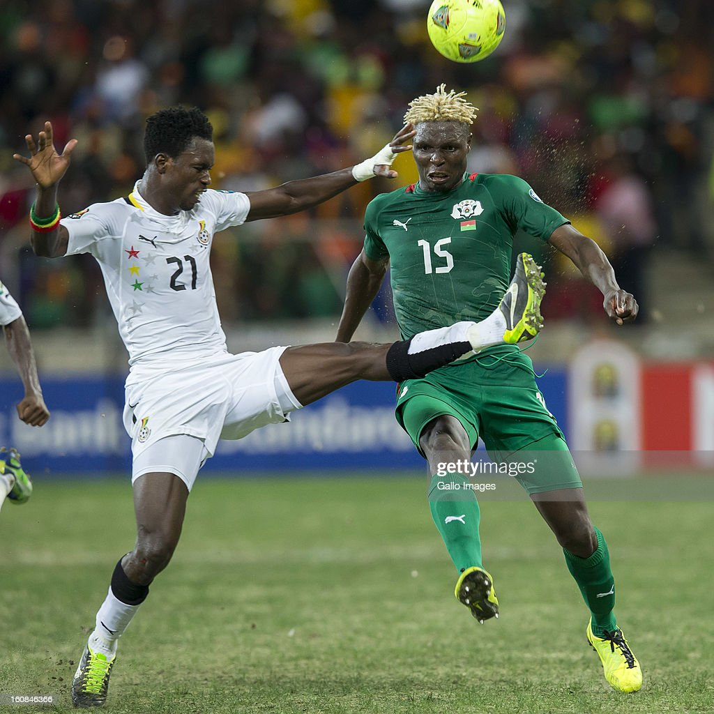 John Boye from Ghana (L) and Aristide Bance from Burkina Faso compete for the ball during the 2013 Orange African Cup of Nations 2nd Semi Final match between Burkina Faso and Ghana at Mbombela Stadium on February 06, 2013 in Nelspruit, South Africa.