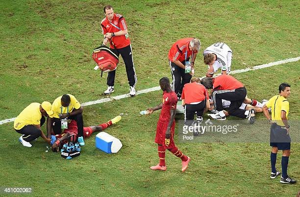 John Boye of Ghana and Thomas Mueller of Germany receive treatment for injuries after a collision during the 2014 FIFA World Cup Brazil Group G match...