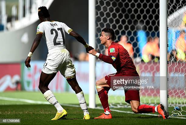 John Boye of Ghana helps Cristiano Ronaldo of Portugal stand up during the 2014 FIFA World Cup Brazil Group G match between Portugal and Ghana at...
