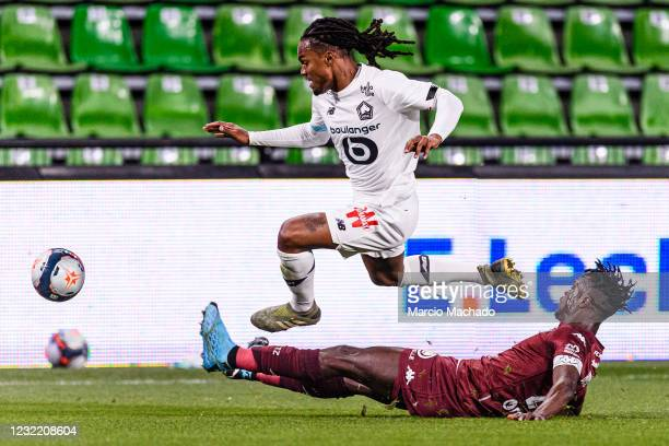 John Boye of Metz battles for the ball with Renato Sanches of Lille during the Ligue 1 match between FC Metz and Lille OSC at Stade Saint-Symphorien...