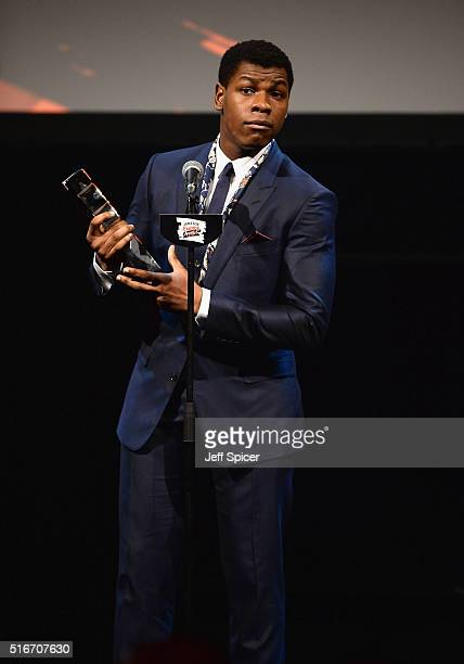 John Boyega accepts the award for Best Male Newcomer on stage during the Jameson Empire Awards 2016 at The Grosvenor House Hotel on March 20 2016 in...