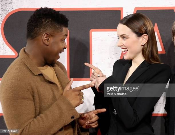 John Boyega and Daisy Ridley attend the 'Star Wars: The Last Jedi' photocall at Corinthia Hotel London on December 13, 2017 in London, England.