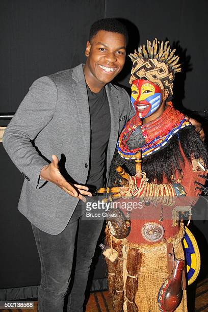 John Boyega and Gugwana Dlaminion as 'Rafiki' pose backstage at Disney's 'The Lion King' on Broadway at The Minskoff Theater on December 20 2015 in...