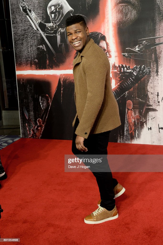 John Boyega attends the 'Star Wars: The Last Jedi' photocall at Corinthia Hotel London on December 13, 2017 in London, England.
