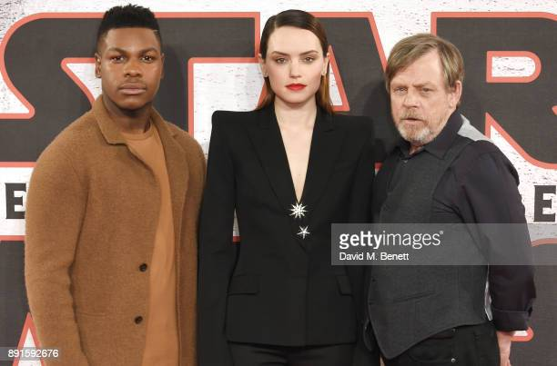 John Boyega Daisy Ridley and Mark Hamill pose at the 'Star Wars The Last Jedi' photocall at Corinthia Hotel London on December 13 2017 in London...