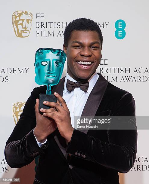John Boyega poses in the winners room at the EE British Academy Film Awards at The Royal Opera House on February 14 2016 in London England