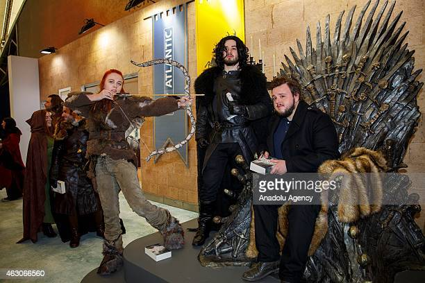 John Bradley signs books of the fans as he opens 'Game of Thrones The Exhibition' at the O2 in London England on February 09 2015 The exhibition...