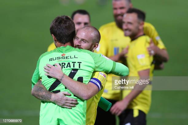 John Brayford and Ben Garratt of Burton Albion celebrate the win on penalties during the Carabao Cup First Round match between Burton Albion and...
