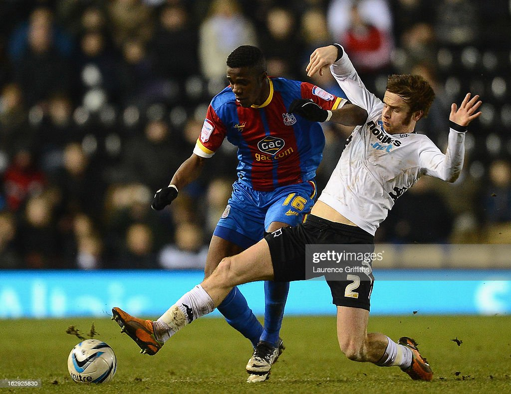 John Brayford of Derby County battles with Wilfried Zaha of Crystal Palace during the npower Championship match between Derby County and Crystal Palace at Pride Park Stadium on March 1, 2013 in Derby, England.