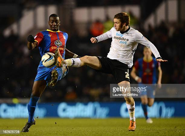 John Brayford of Derby County battles with Yannick Bolaise of Crystal Palace during the npower Championship match between Derby County and Crystal...