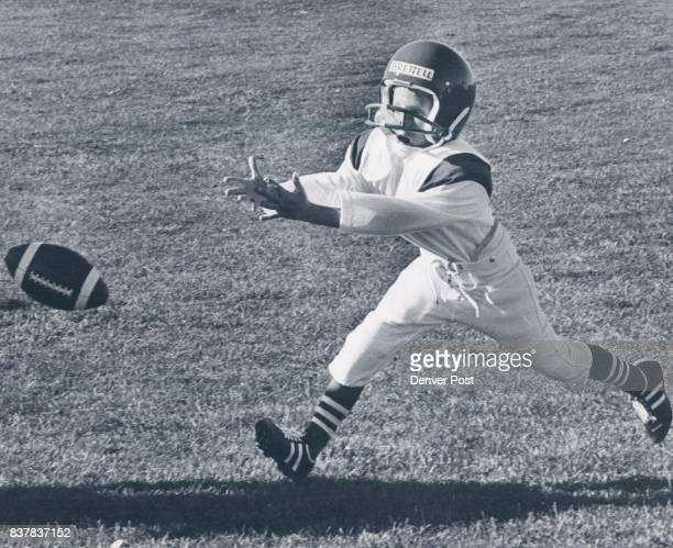 John Brettell 68315 Downing CRW John Brettell gives it his all as goes after the Football Football * Young America League Credit Denver Post