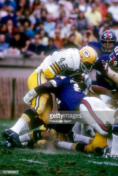 John Brockington of the Green Bay Packers is tackled by Chuck Crist of the New York Giants during an NFL football game at Yankee Stadium October 7...