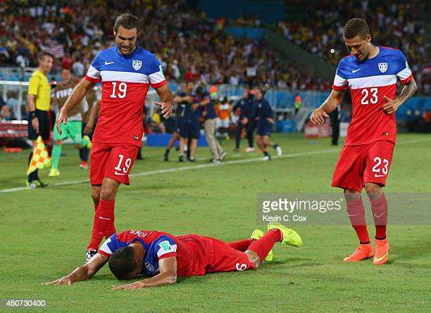 John Brooks of the United States celebrates scoring his team's second goal with Graham Zusi and Fabian Johnson during the 2014 FIFA World Cup Brazil...