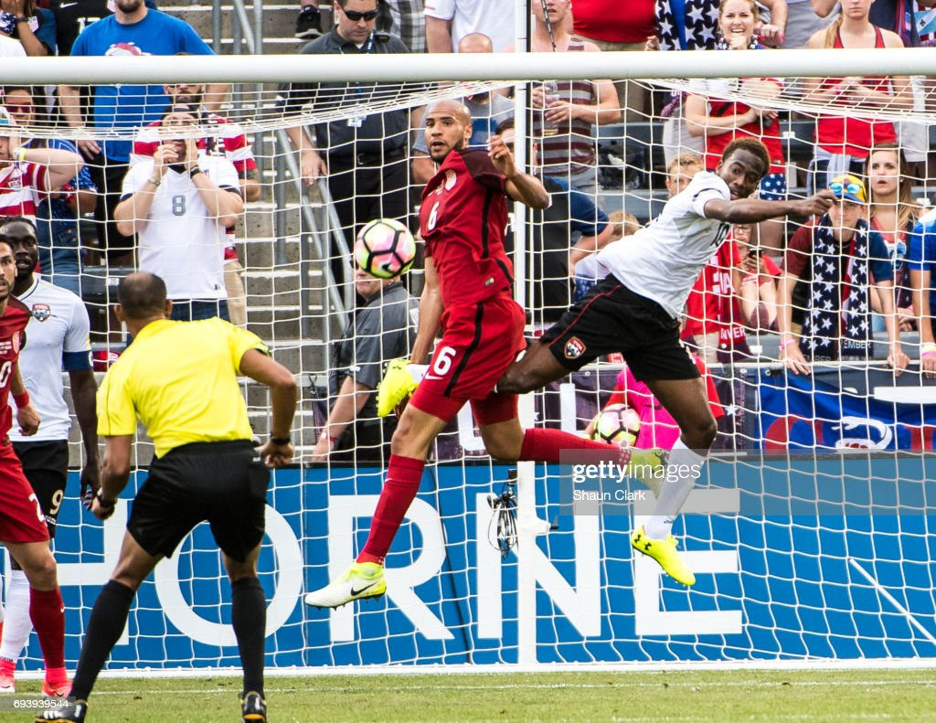 John Brooks #6 of United States battles Kevin Molino #10 of Trinidad & Tobago during the World Cup Qualifier match between the United States and Trinidad & Tobago at Dick's Sporting Goods Park on June 8, 2017 in Commerce City, Colorado. The United States won the match 2-0