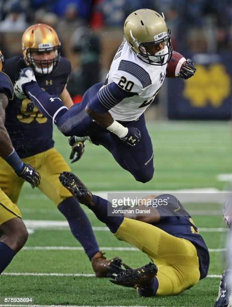 John Brown III of the Navy Midshipmen is upended by Shaun Crawford of the Notre Dame Fighting Irish at Notre Dame Stadium on November 18 2017 in...